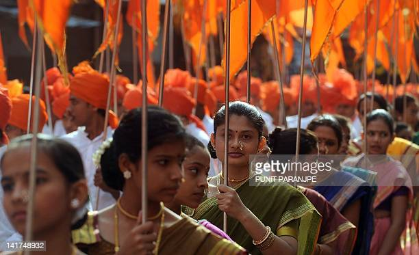 Indian women dressed in traditional attire take part in a procession celebrating 'Gudhi Padwa' or the Maharashtrian new year in Mumbai on March 23...