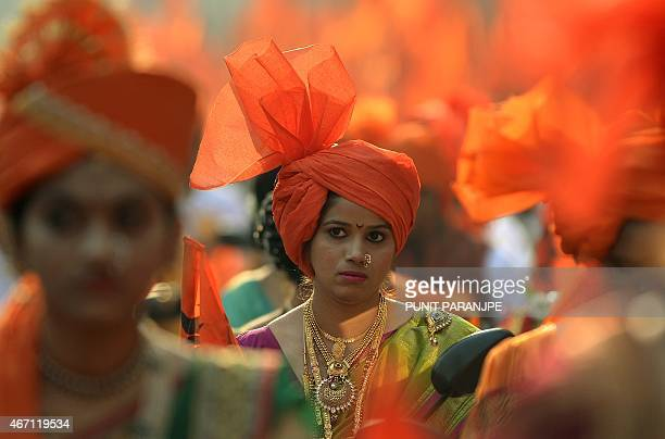 Indian women dressed in traditional attire take part in a procession celebrating 'Gudhi Padwa' or the Maharashtrian new year in Mumbai on March 21...