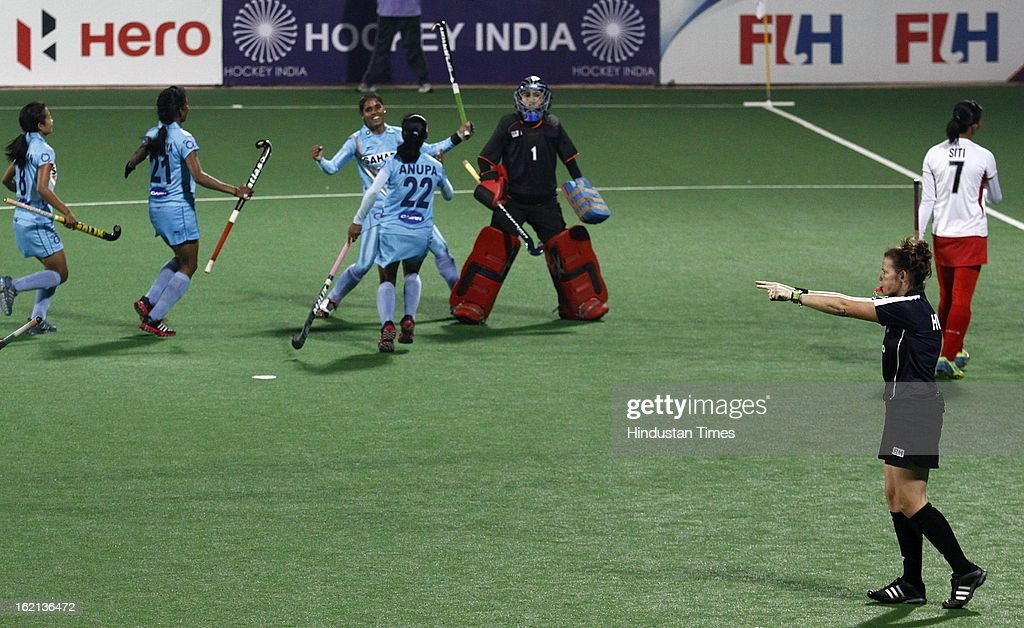 Indian Women Hockey Player Vandana Kataria with team mates celebrates after scoring a goal against the Malaysia during the Hockey World League Round 2 match at Dhyan Chand Stadium on February 19, 2013 in New Delhi, India. Indian Eves won the match 3-0.