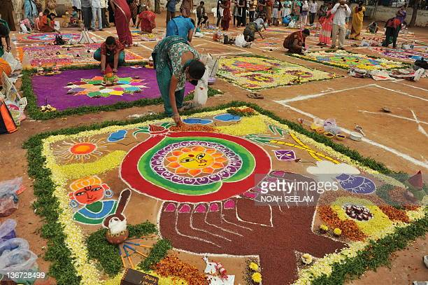 Indian women participate in a Rangoli competition in Hyderabad on January 11 2012 Rangoli is a traditional decorative folk art from India These are...