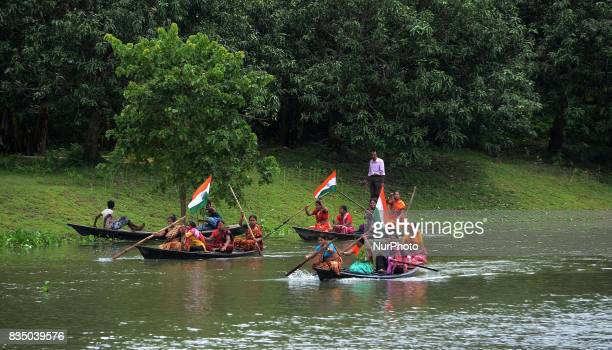 Indian women participates in Boat Race on Churni River on the occasion of Independence Day celebration in Shivnibas Nadia district 95 km from Kolkata...