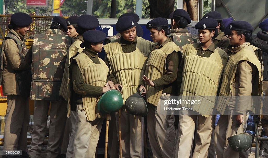 Indian women police stand guard at Jantar Mantar during a protest against a gang rape on January 6, 2013 in New Delhi, India. Hundreds of protesters gathered here under the leadership of BJP Delhi unit president Vijendra Gupta, and raised slogans against the Congress-led UPA Government and Delhi Police.