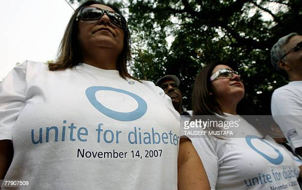 Indian women prepare to participate in the Diabetes Walk on the occasion of the first United Nations mandated World Diabetes Day in New Delhi 14...