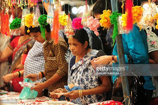 Indian women shop for 'rakhi' at a market ahead of the Hindu festival of Raksha Bandhan in Allahabad on August 23 2015 AFP PHOTO/ SANJAY KANOJIA
