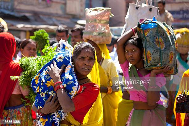 Indian women shopping in old town Udaipur Rajasthan Western India Hindus and Muslims together