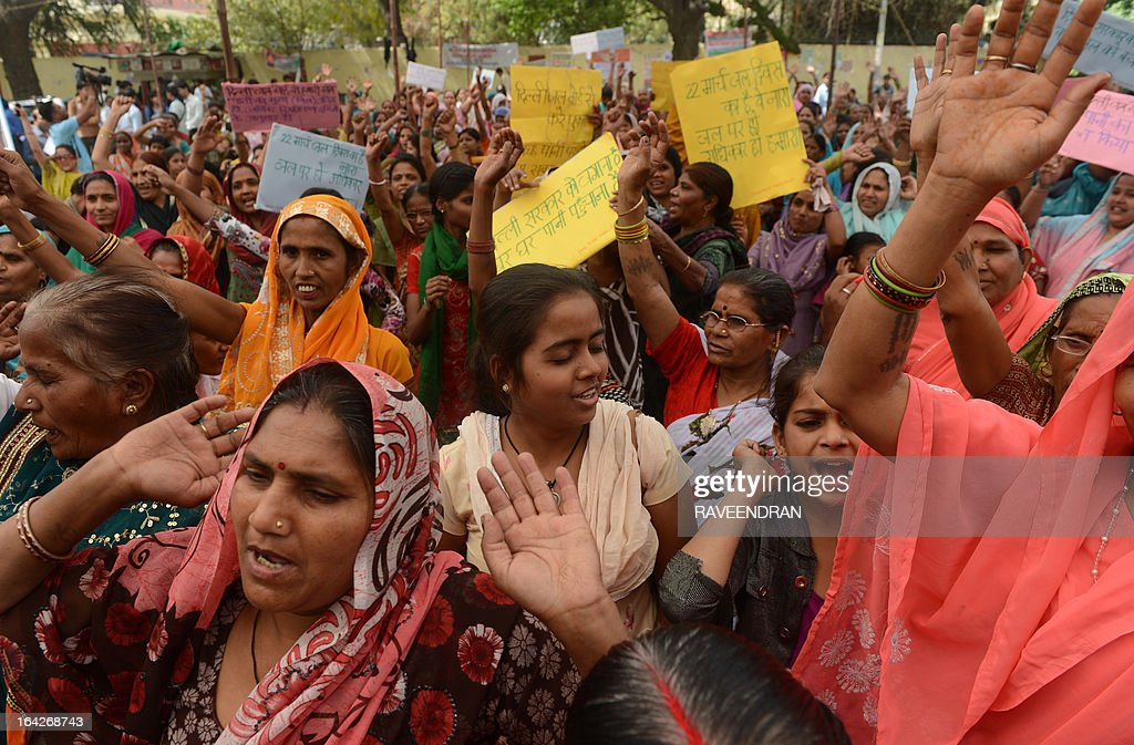 Indian women shout anti-government slogans during a demonstration against the shortage of drinking water in their residential colony on World Water Day in New Delhi on March 22, 2013. Hundreds of activists marched towards parliament demanding that the government guarantees the supply of clean drinking water, as ordered by the Supreme Court of India.