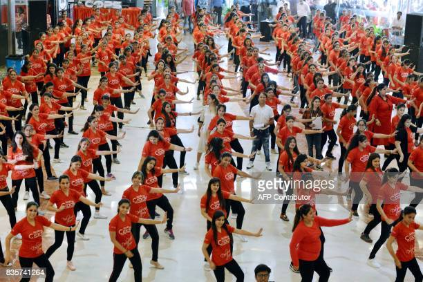 Indian women take part in an attempt to break the Guinness World Record for the largest 'Disco Dance' to highlight women empowerment in Amritsar on...