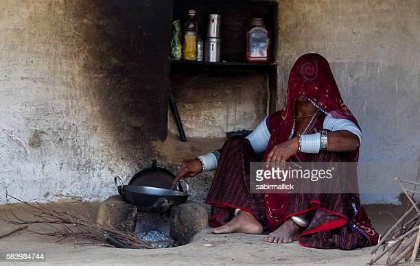 Indian women working in her kitchen