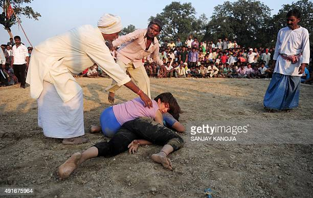 Indian women wrestlers perform during a traditional wrestling competition at a fair held annually on October 7 in Rampur village near Allahabad on...