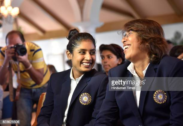 Indian Women's Cricket team captain Mithali Raj shares light moment with teammate Jhulan Goswami during the felicitating event on July 27 2017 in New...