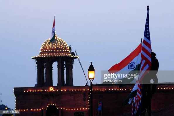 Indian worker putting up INDIA and US flag at Raisina Hill before US President Barack Obama visit to attend the Republic Day celebrations in India...