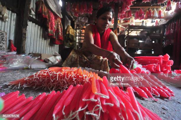 Indian workers are busy in making candles ahead of Diwali festival in Agartala India People buy earthen lamps to decorate their homes during Diwali...