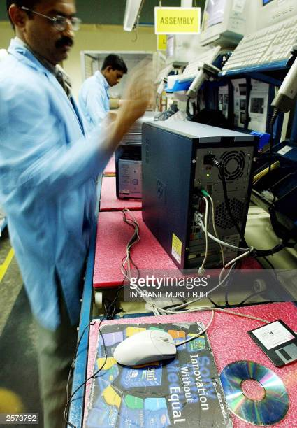 Indian workers assemble computer CPU's in the assembly line at the Hewlett Packard India's manufacturing facility in the India Configuration Centre...