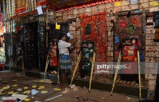 Indian workers busy in decorates the puja pandal or temporary platform ahead of Durga Puja festival in Kolkata India on Wednesday 20th September 2017...