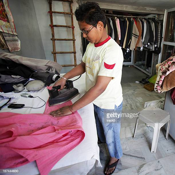 Indian workers: ironing clothes