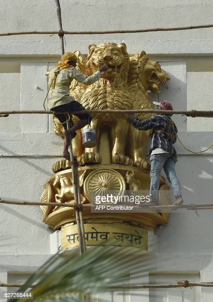 Indian workers paint a statue of the national emblem a depiction of tbe Sarnath Lion Capital of Ashoka ahead of the forthcoming Independence day...
