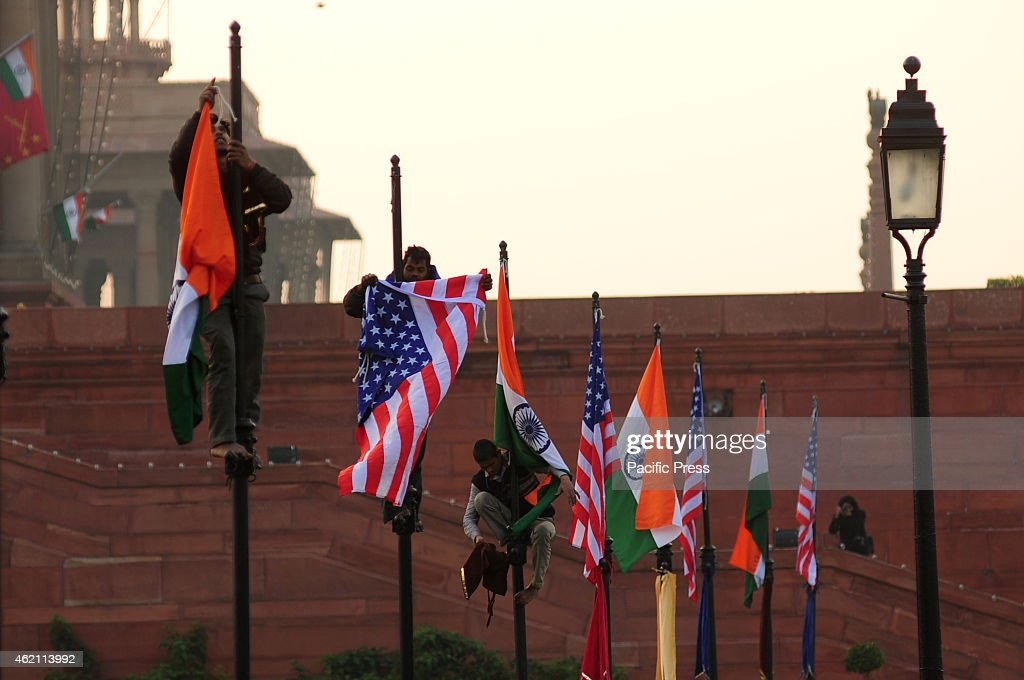 Indian workers putting up INDIA and US flag at Raisina Hill before US President Barack Obama visit to attend the Republic Day celebrations in India...