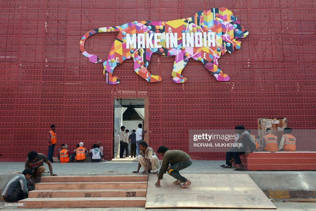 Indian workers set up the venue for the 'Make in India' showcase week in Mumbai on February 11, 2016. Over 190 companies, including national conglomerates and multinational corporations, 5,000 delegates from 60 countries, and leading industrialists including Ratan Tata and Mukesh Ambani will be participating in the maiden 'Make in India' showcase to be held in Mumbai from February 13-18. AFP PHOTO/ INDRANIL MUKHERJEE / AFP / INDRANIL MUKHERJEE
