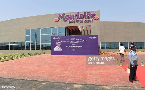 Indian workers stand outside the Mondelez International facility as it it opened in Sri City in the Indian state of Andhra Pradesh on 25 April 2016...