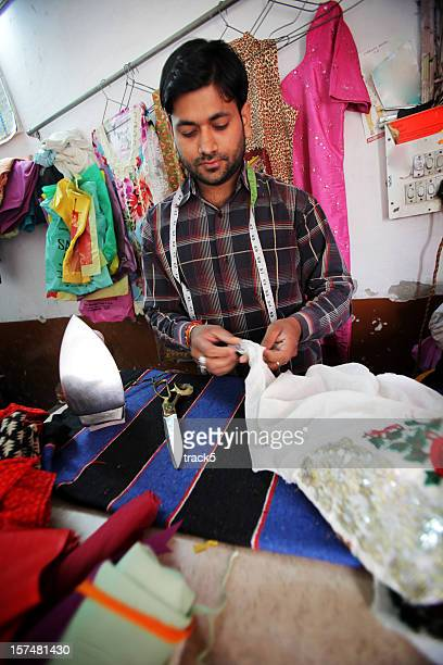 Indian workers: tailor at work