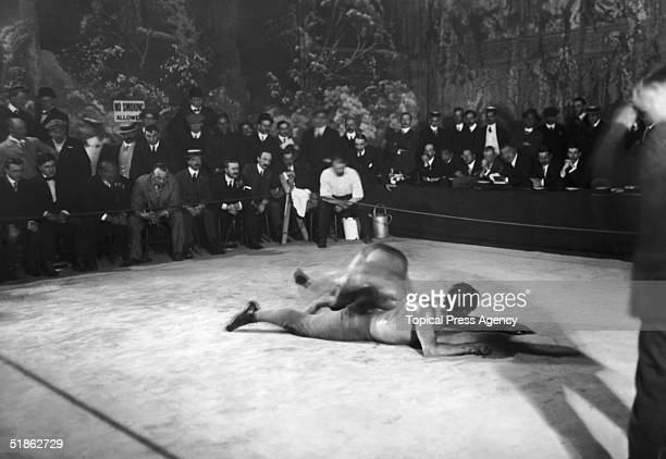 Indian wrestler Gama and his American opponent Benjamin 'Doc' Roller during a match at the Alhambra Theatre 8th August 1910 Gama won the fight within...