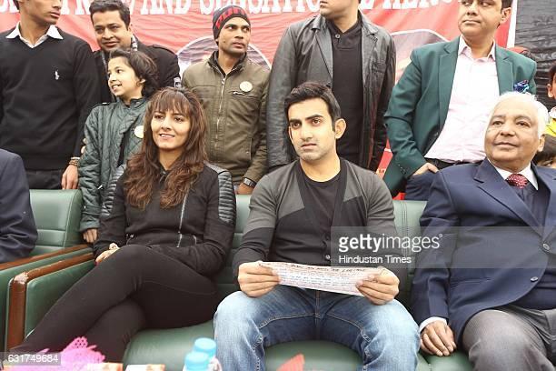 Indian wrestler Geeta Phogat and cricketer Gautam Gambhir during the centennial celebrations at Ramjas College Delhi University on January 12 2017 in...