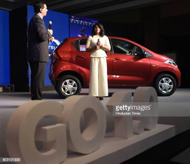 Indian wrestler Sakshi Malik and Arun Malhotra Managing Director of Nissan Motor India talking to media during the launch of new Datsun RediGo with...
