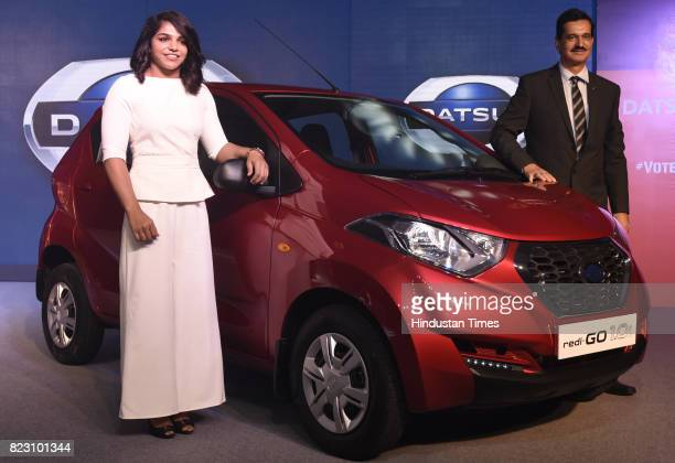 Indian wrestler Sakshi Malik and Arun Malhotra Managing Director of Nissan Motor India pose with new Datsun RediGo with one litre petrol engine on...