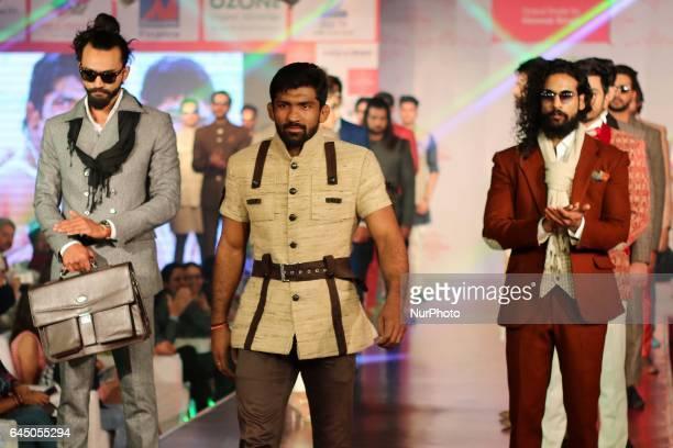 Indian Wrestler Yogeshwar Dutt walk the ramp showcasing their designer collection during the Jaipur Couture Fashion Show in JaipurRajasthan India on...
