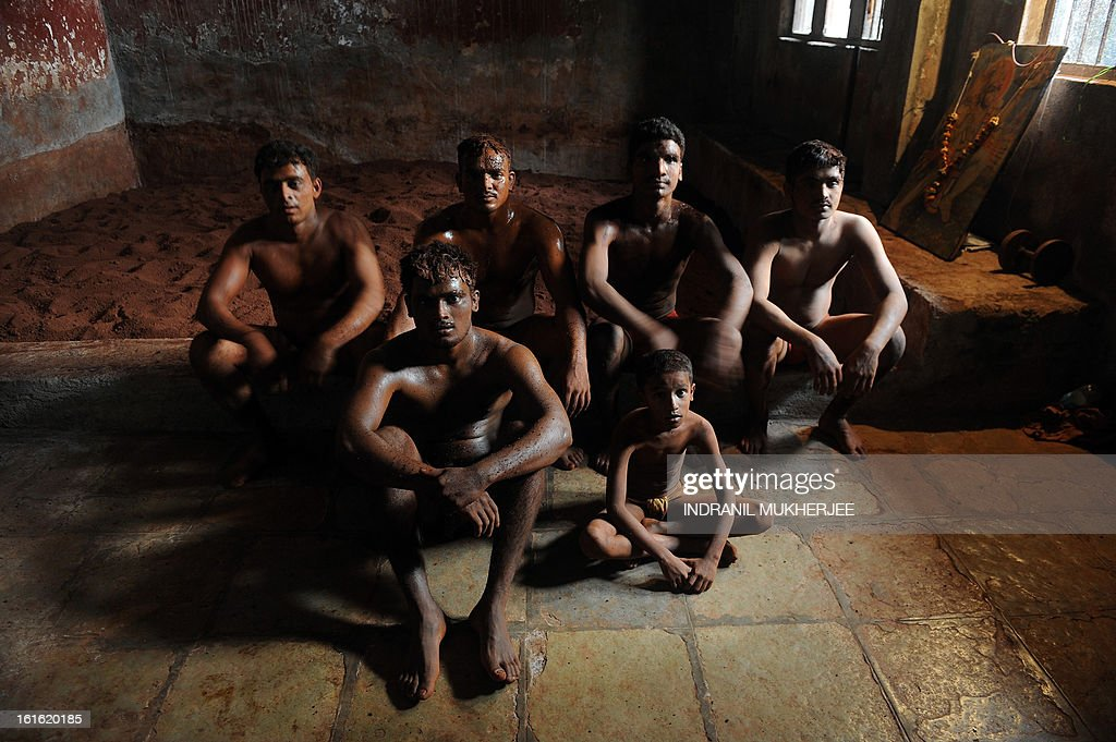 Indian wrestlers listen to an unseen senior after a training session at the Mahatma Phule Vyayam Mandir Kushti (traditional Indian wrestling) academy in Mumbai on February 13, 2013. Wrestlers around the world on Wednesday vowed to fight to save the ancient sport's Olympic status, after the International Olympic Committee voted to drop it for the 2020 Games. AFP PHOTO/Indranil MUKHERJEE