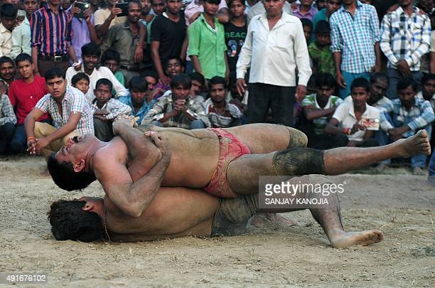 Indian wrestlers perform during a traditional wrestling competition at a fair held annually on October 7 in Rampur village near Allahabad on October...