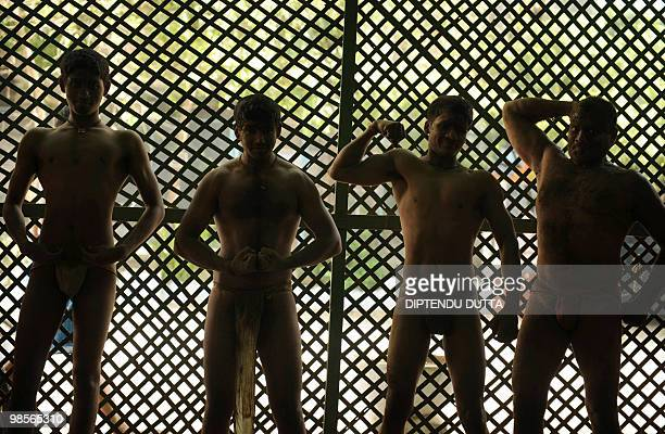 Indian wrestlers pose during a training session at Loknath Akhara in Allahabad on April 19 2010 India's indigenous form of wrestling and once a royal...