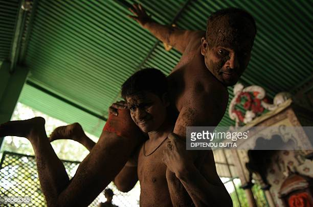 Indian wrestlers practice at Loknath Akhara in Allahabad on April 19 2010 India's indigenous form of wrestling and once a royal national sport Akhara...