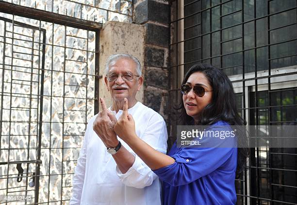 Indian writer Gulzar and his daughter the director Meghana Gulzar pose for a photograph after voting at a polling station in Mumbai on April 24 2014...