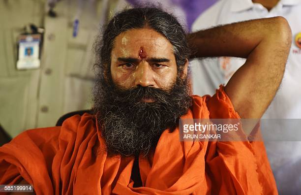 Indian yoga and spiritual figure Baba Ramdev looks on during the opening of the Hindu Spritual and Service Fair in Chennai on August 2 2016 / AFP /...