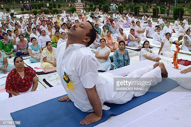 Indian yoga enthusiasts perform yoga on International Yoga Day in Amritsar on June 21 2015 Prime Minister Narendra Modi on June 21 hailed the first...