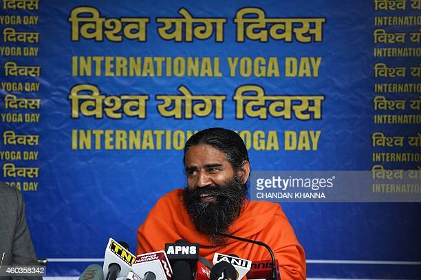 Indian yoga guru Baba Ramdev gestures as he speaks to the media during a press conference in New Delhi on December 12 2014 Yoga guru Baba Ramdev...