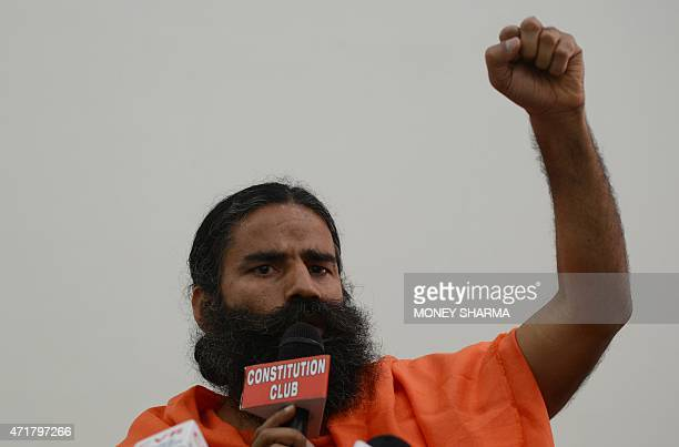 Indian yoga guru Baba Ramdev gestures during a press conference in New Delhi on May 1 2015 A hugely popular Indian guru launched a defence of one of...