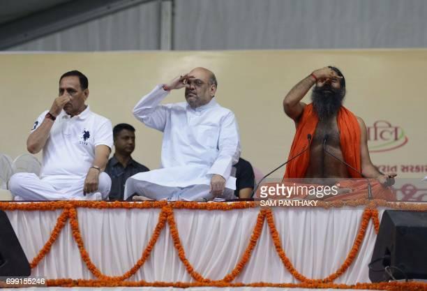 Indian yoga guru Baba Ramdevji Bharatiya Janata Party president Amit Shah and Gujarat Chief Minister Vijaybhai Rupani and take part in a massive yoga...