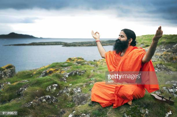Indian yoga guru Baba Swami Ramdev practices yoga on the island of Little Cumbrae off the west coast of Scotland on September 27 2009 According to...