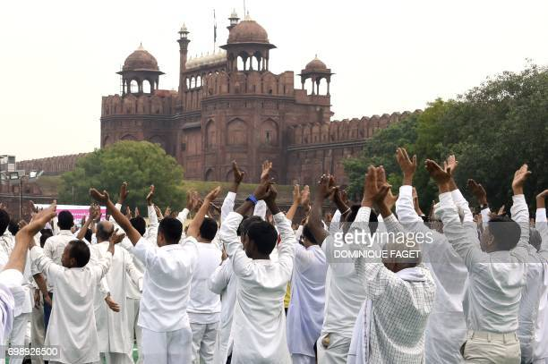 Indian yoga practitioners participate in a mass yoga session on International Yoga Day in front of The Red Fort in New Delhi on June 21 2017 The...