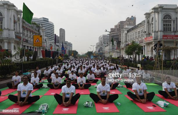 Indian yoga practitioners participate in a mass yoga session on International Yoga Day in New Delhi on June 21 2017 Yoga has connected the world with...
