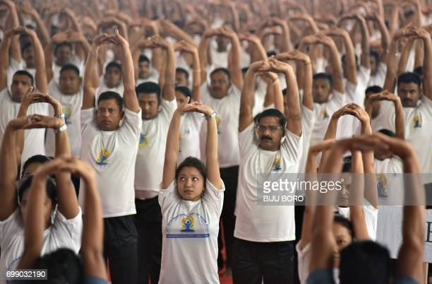 Indian yoga practitioners participate in a mass yoga session on International Yoga Day in Guwahati on June 21 2017 Yoga has connected the world with...