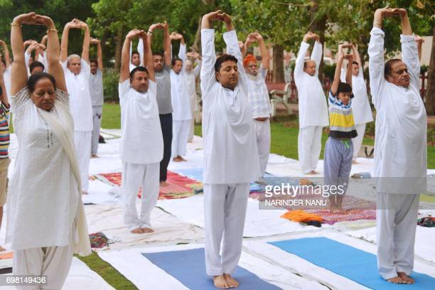 Indian yoga practitioners participate in a session at a park in Amritsar on June 20 2017 ahead of the International Yoga Day International Yoga Day...