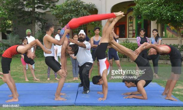 Indian yoga students pose for a photograph during a rehearsal for an event to mark International Yoga Day in Amritsar on June 20 2017 International...