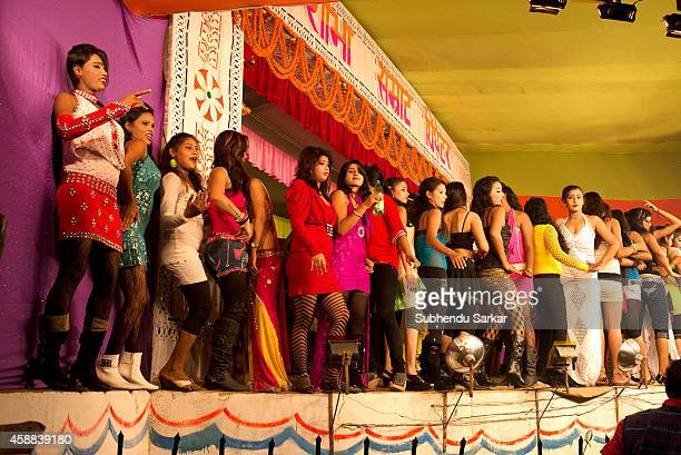 Indian young ladies dance on stage which men watch after paying for tickets at Sonepur fair ground The Sonepur Cattle Fair is the largest cattle fair...