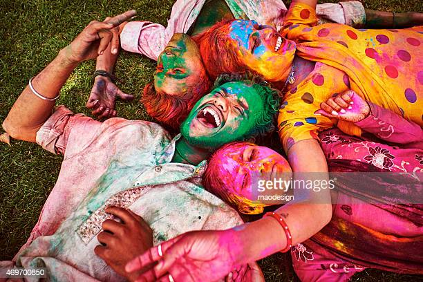 Indian Young People lying on meadow Celebrating Happy Holi Festival