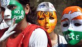 Indian youth activists wear masks carrying slogans for peace as they take part in a rally to mark Hiroshima Day in Mumbai on August 6 2014 Peace...