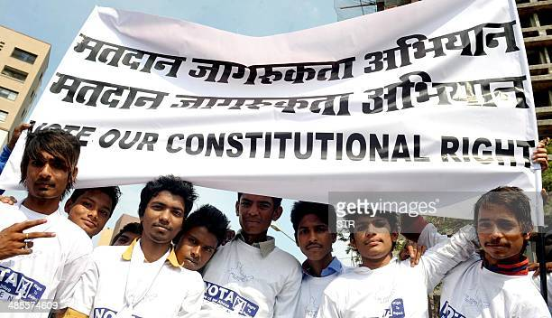 Indian youth call for the masses to join their voice after the Supreme Court allotted a button on voting machines None Of The Above in Mumbai on...