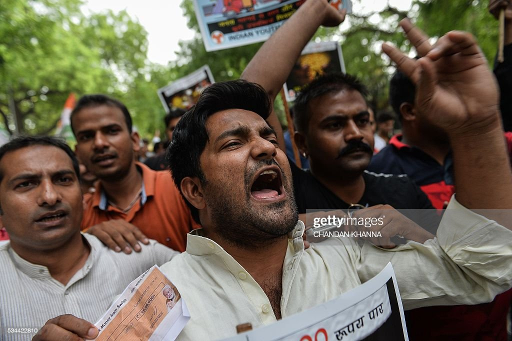 Indian Youth Congress (IYC) activists shout anti government slogans during a protest following the completion of two years of the Narendra Modi-led National Democratic Alliance (NDA) in New Delhi on May 26, 2016. Prime Minister Narendra Modi has defended his record of reforming India's stuttering economy after two years in power, but conceded that his right-wing government faced 'an enormous task ahead'. KHANNA
